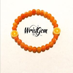 "WristGem ""Orange Juice"" Crackle Beaded Bracelet."